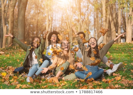 man and woman throwing leaves Stock photo © photography33