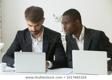 Perplexed man in suit staring at laptop computer Stock photo © photography33