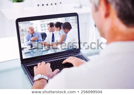 mature businesswoman and man using a laptop stock photo © photography33