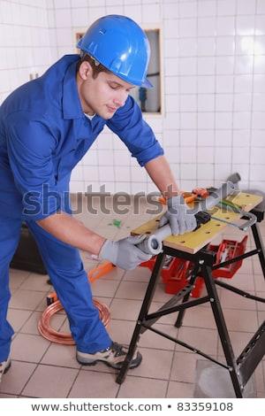 Laborer bending copper tube Stock photo © photography33