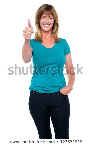 カジュアル · 女性 · ポーズ · 親指 · ポケット - ストックフォト © stockyimages