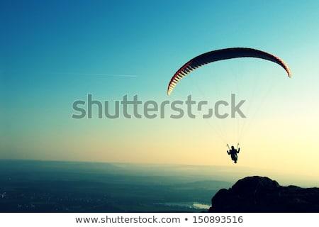 Siklórepülés extrém sport extrém aktív kék ég szabadság Stock fotó © Studiotrebuchet