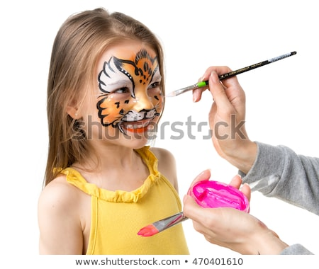 pretty girl with carnival mask painted on face Stock photo © carlodapino