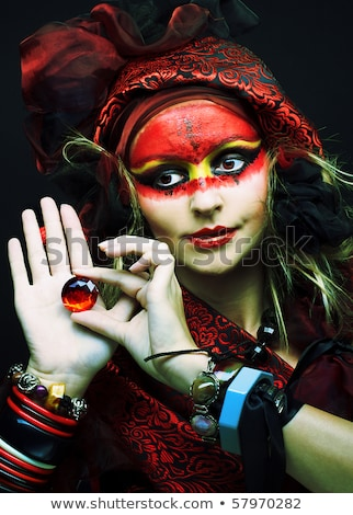 young blonde with painted carnival mask on face stock photo © carlodapino
