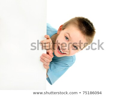 Smiling young boy behind the blank board stock photo © get4net