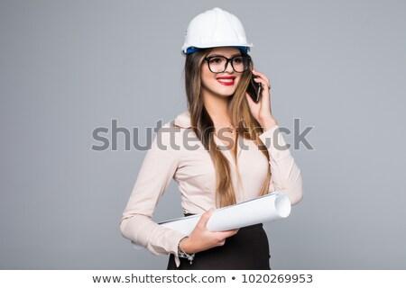 Assertive female architecture talking on phone wearing a hat against white background Stock photo © wavebreak_media