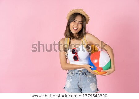 Morena menina brinquedo coração praia Foto stock © Massonforstock