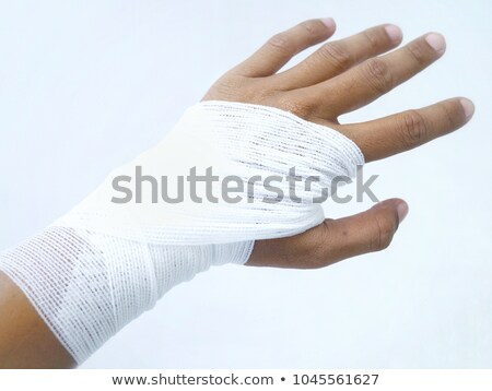 Doctor wrapping gauze around wrist Stock photo © photography33