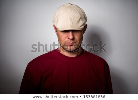 casual man with hat pulled down Stock photo © feedough