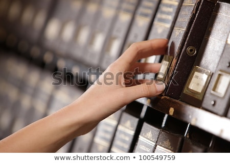 Searching in archives. Student hands searching from a filling ca Stock photo © stokkete