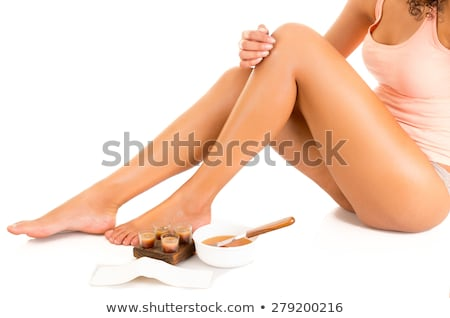 Woman caressing her silky smooth legs Stock photo © AndreyPopov
