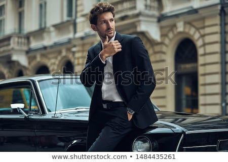 Elegáns férfi modell retro autó kék égbolt Stock fotó © konradbak