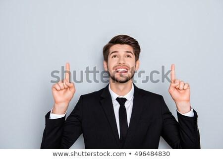 smiling businessman raise finger up Stock photo © PetrMalyshev