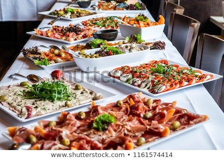 Sliced baguette and rolls on a buffet table Stock photo © ozgur