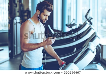 Fit man running on treadmill listening to music Stock photo © wavebreak_media