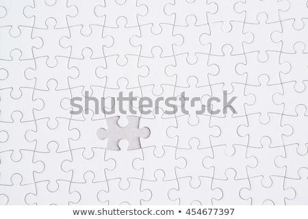 positivity   jigsaw puzzle with missing pieces stock photo © tashatuvango