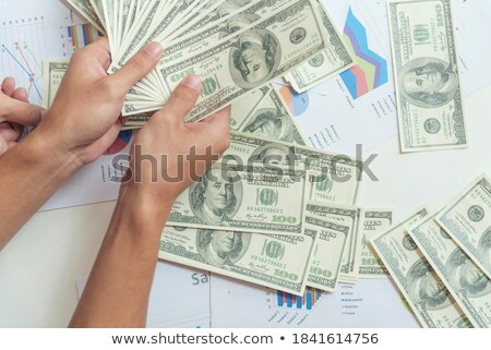 Businessman from bank offering money loan in USA dollar banknote Stock photo © stevanovicigor