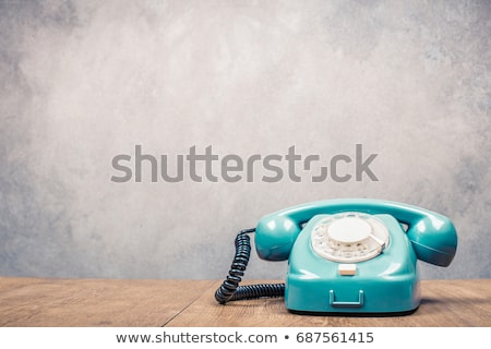 Contact Us on wooden table Stock photo © fuzzbones0