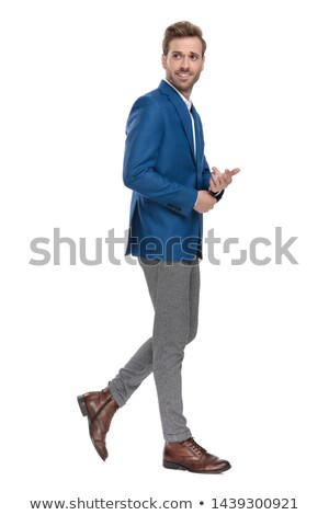 side view of a young business man fixing his sleeve Stock photo © feedough