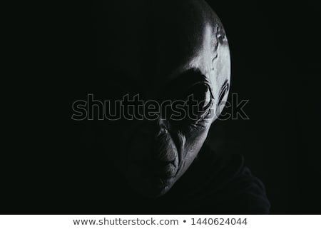 A grey planet with a face Stock photo © bluering