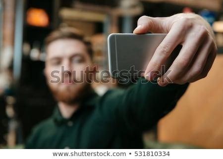Handsome man in barbershop take a selfie Stock photo © deandrobot