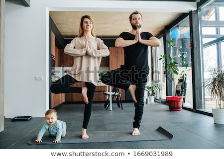 woman standing in yoga position stock photo © lightfieldstudios
