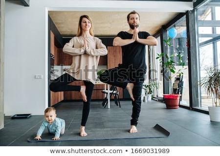 Woman standing in yoga position Stock photo © LightFieldStudios
