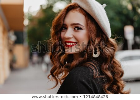 Attractive young woman with red lips looking back Stock photo © deandrobot