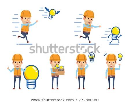 builder pointing at bright idea light bulb stock photo © rastudio