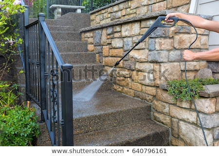 Сток-фото: Pressure Power Washing The Front Entrance Stair Steps