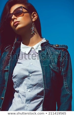 Stock photo: Grunge styled portrait of gorgoeus young brunette in sunglasses.