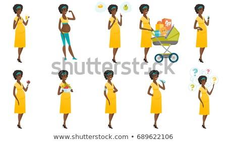 Jonge zwangere vrouw kinderwagen vol presenteert lopen Stockfoto © RAStudio