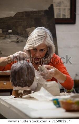 Attentif supérieurs femme argile sculpture Photo stock © wavebreak_media