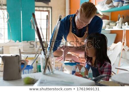 Stockfoto: Mannelijke · meisje · verf · kom · aardewerk · workshop