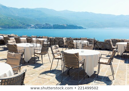 View to a restaurant terrace, sea and mountains Stock photo © frimufilms