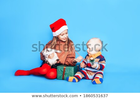 boy handing box to his brother Stock photo © IS2