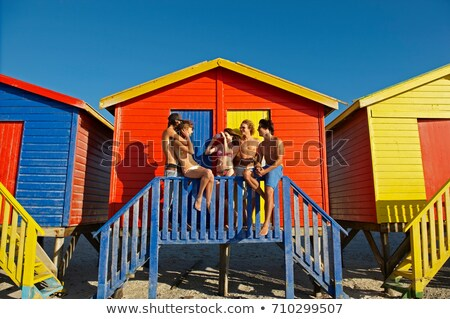 Young people hanging out by beach hut Stock photo © IS2
