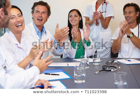 Doctors applauding their chief Stock photo © IS2