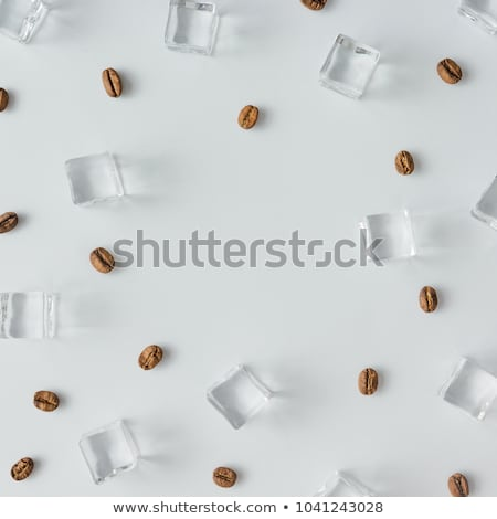 Stockfoto: Pattern Of Cold Ice Cubes On A Blue Background Flat Lay