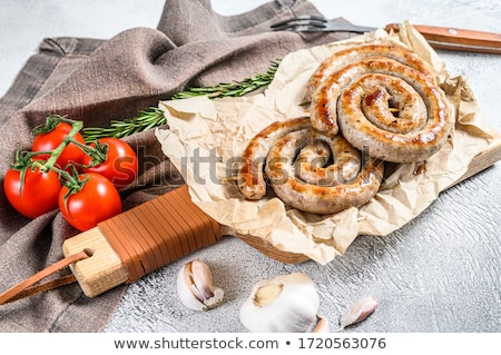 grilled or roasted spiral pork sausages with rosemary stok fotoğraf © illia