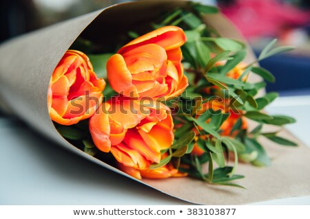 Stock photo: orange tulips packagedon a old wooden background