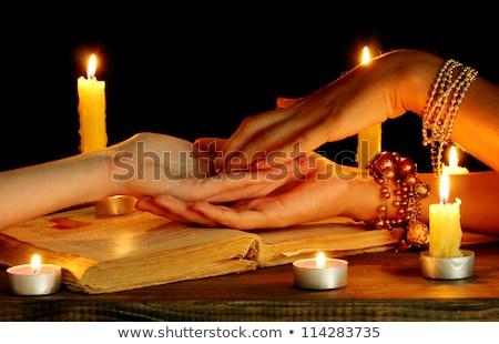 Woman fortune teller Gypsy. Palmistry hand Stock photo © studiostoks