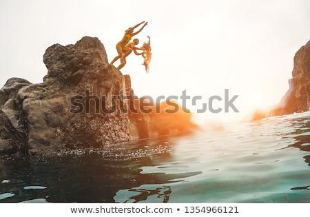 People diving in the ocean Stock photo © colematt
