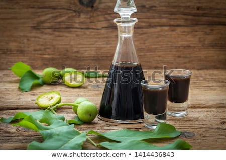 Two glasses of homemade nut liqueur with walnuts Stock photo © madeleine_steinbach