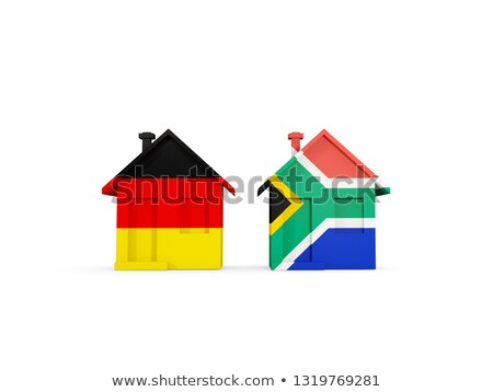 Two houses with flags of Germany and south africa Stock photo © MikhailMishchenko