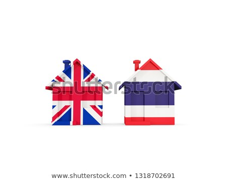 Stock photo: Two houses with flags of United Kingdom and thailand