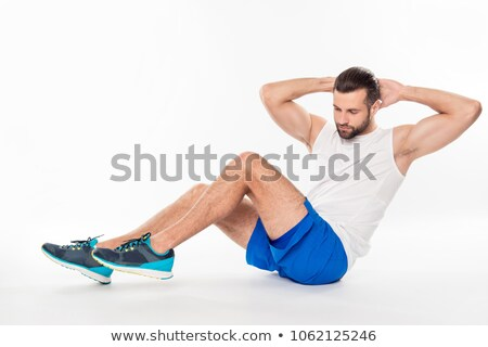 Portrait of a concentrated sportsman doing exercises Stock photo © deandrobot
