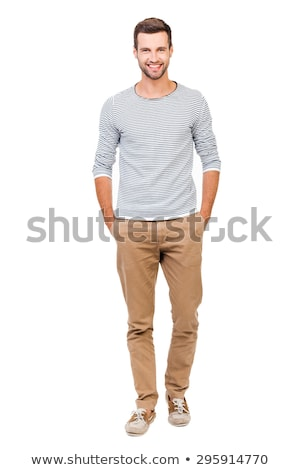 young elegant man standing with hand in pocket and smiles Stock photo © feedough