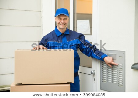 man using intercom to enter home for delivery stock photo © andreypopov