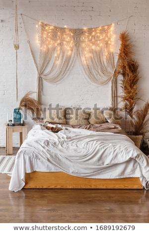 White and beige bedroom in boho style with macrame  Stock photo © dashapetrenko